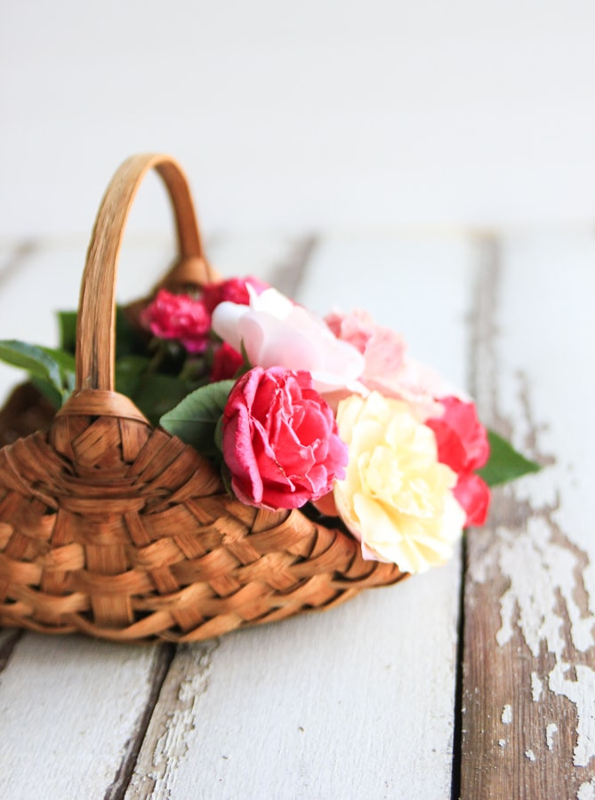 Old handmade basket with flowers