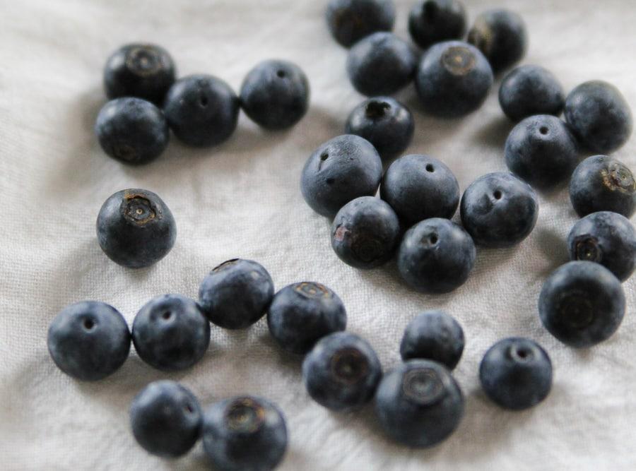 Fresh Blueberries on white towel