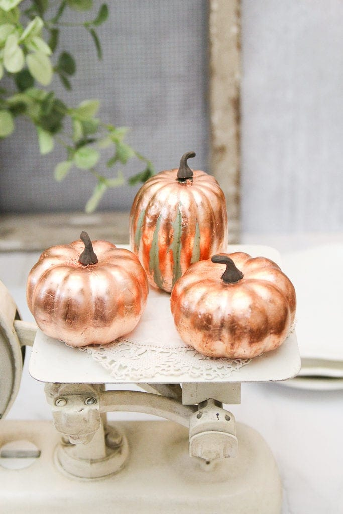 Two solid and one distressed copper leaf pumpkin