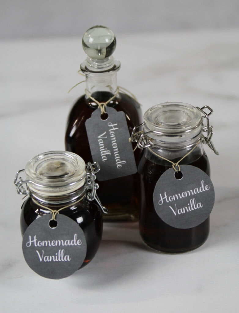 Small bottles of homemade vanilla with printable tags