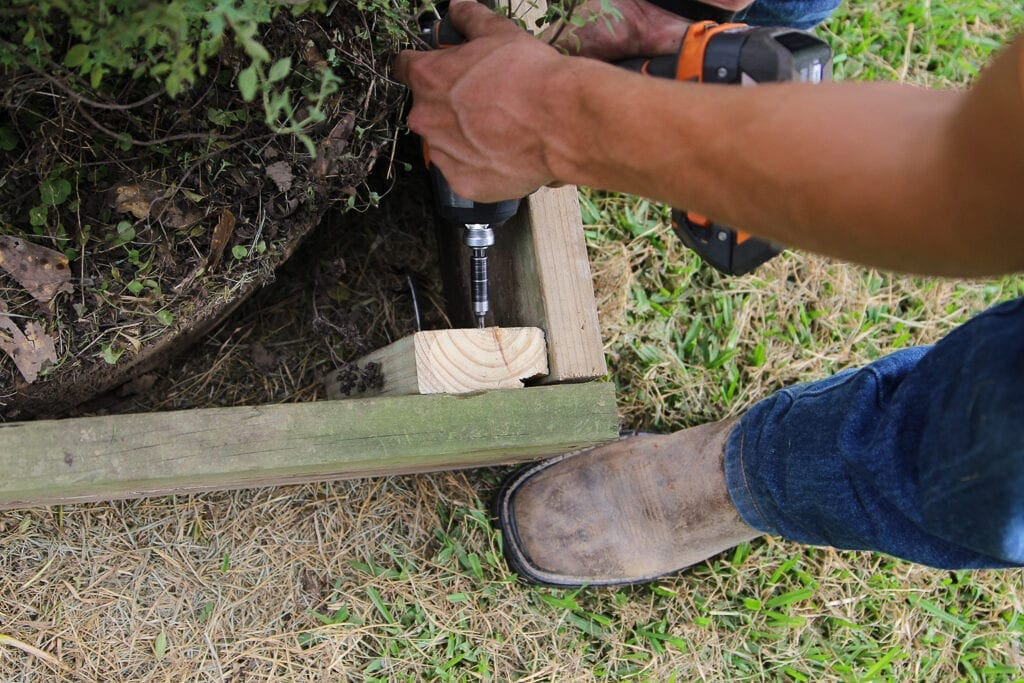 attaching the garden bed to the stake