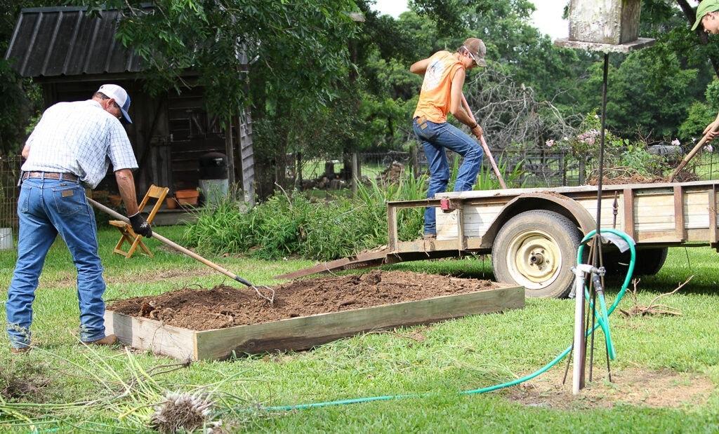 finishing filling the raised garden bed